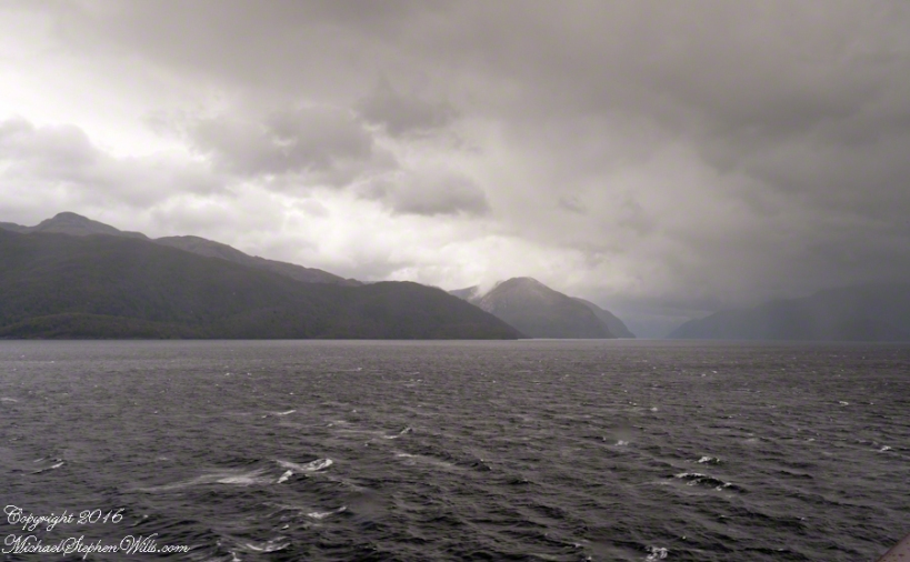 View Southeast with Estacion Point and Headland to left.  Behind the headland is the entrance to Farquhar Fjord.  Tempanos Fjord is framed by land on both sides.
