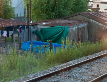 famjilies use these pools to cool off. Seen from a Uruguay National rail car the evening of February 26, 2016 travelling south from the Colon Station to Estación Central General Artigas, Montevideo.
