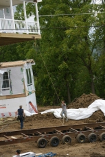 A 180 degree turn orients Trailer One to Trailer Two. The porch overhangs the foundation.