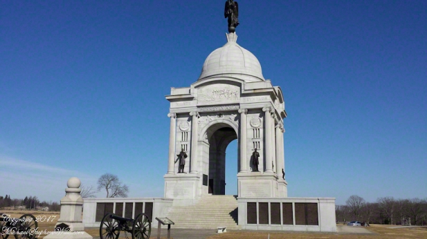 The Pennsylvania Memorial near the Highwater Mark of the 1863 Battle of Gettysburg. South side of the memorial with bronze tablets listing the 34,538 Pennsylvania soldiers who participated in the battle. President Lincoln is the statue on left, Preesylvania Govenor Andrew Curtin on the right.